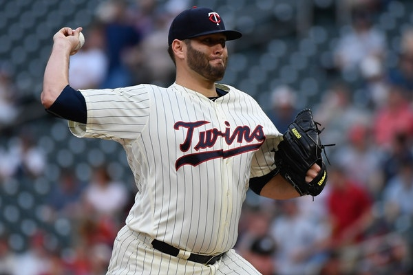 Minnesota Twins starting pitcher Lance Lynn (31) threw a pitch in the top of the first inning against the Boston Red Sox.
