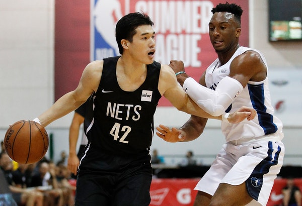 Brooklyn Nets' Yuta Watanabe (42) drives around Minnesota Timberwolves' Josh Okogie during the first half of an NBA summer league basketball game, Mon