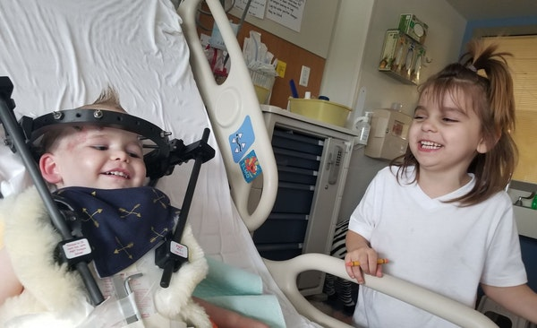 Lillianna Peltier cheered up her brother Kayden during a hospital visit nearly a month after he was seriously injured by an SUV that led police on a h