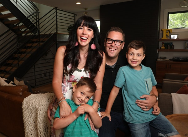 Heather and Brad Fox at home in Edina with their sons, Wesley and Graham.