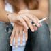 iStockphoto.com Teenage hands holding cigarette outdoor.