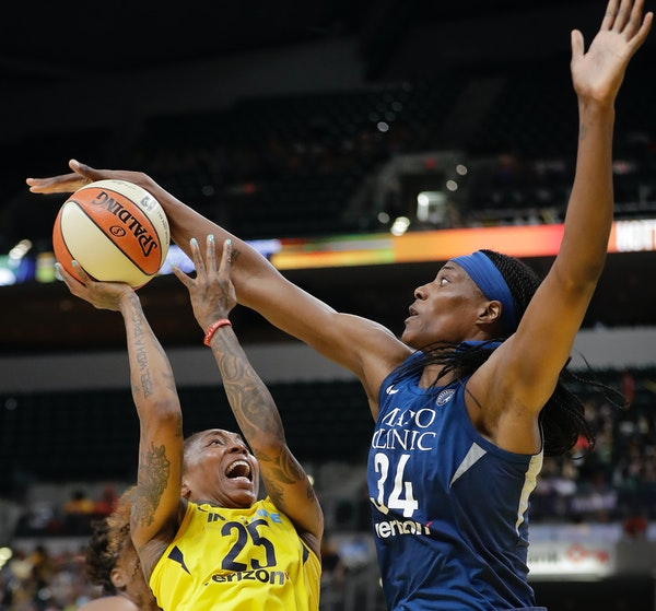 Indiana Fever's Cappie Pondexter (25) is fouled by Minnesota Lynx's Sylvia Fowles during the second half Wednesday.