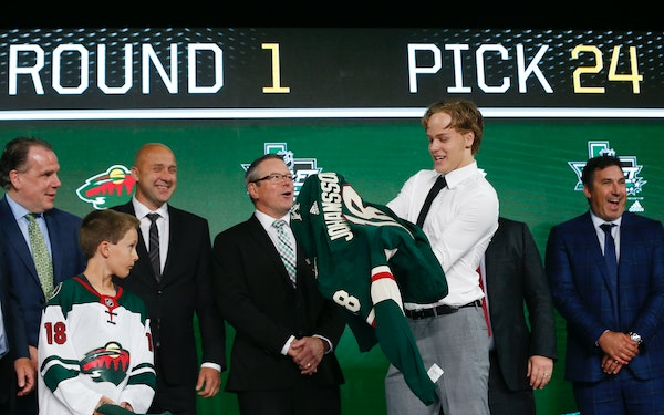Filip Johansson of Sweden slipped on a jersey after being selected by the Wild during the first round of the NHL draft in Dallas on June 22.
