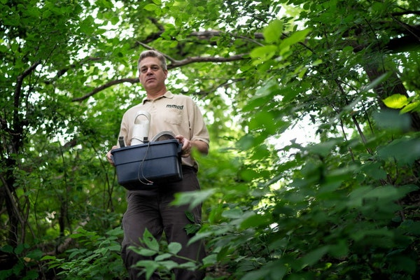 Kirk Johnson, vector ecologist for the Metropolitan Mosquito Control District, set up traps in Lauderdale.