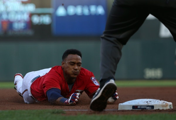 Jorge Polanco slides into third base with a triple against the Tampa Bay Rays on Friday