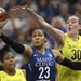 Lynx forward Maya Moore shot under the hoop while defended by Seattle forward Breanna Stewart on Tuesday.