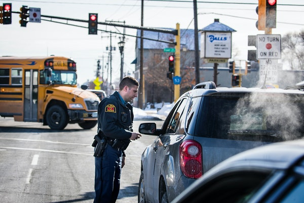 St. Paul Police motor officer John Conrad gives a ticket for speeding to a driver he pulled over on Dale Street.