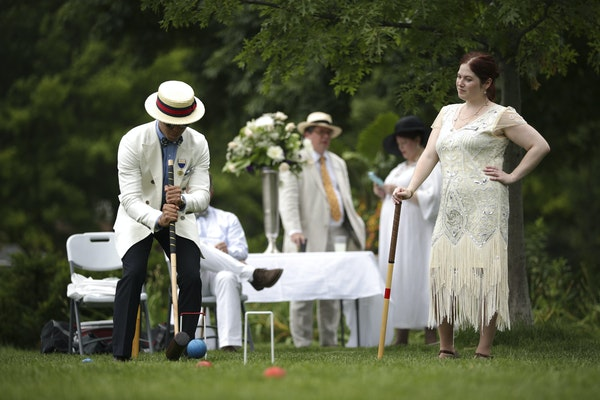 Sonny Sawansuk took his shot while Grace Schwab awaited her turn. The two are a part of the North Star Croquet Association in St. Paul.