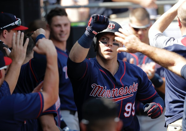Logan Morrison celebrates his home run off White Sox starting pitcher Lucas Giolito, in the seventh inning
