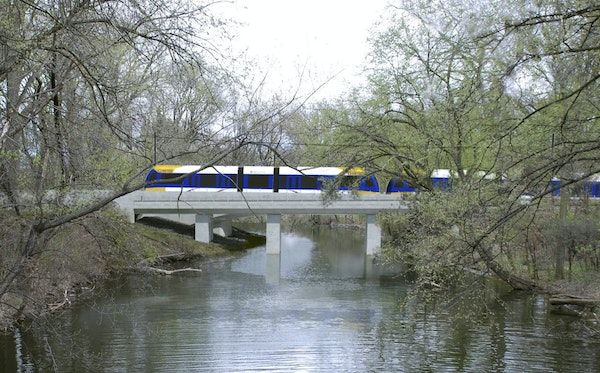 A rendering of the Southwest Light Rail train passing through the Kenilworth Lagoon.