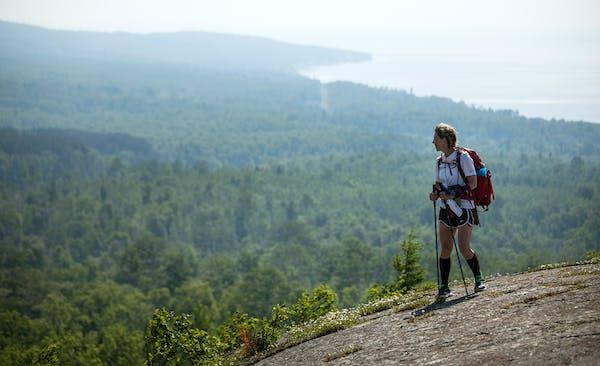 Melanie Radzicki McManus hiked across the open rock face of Pincushion Mountain near Grand Marais.