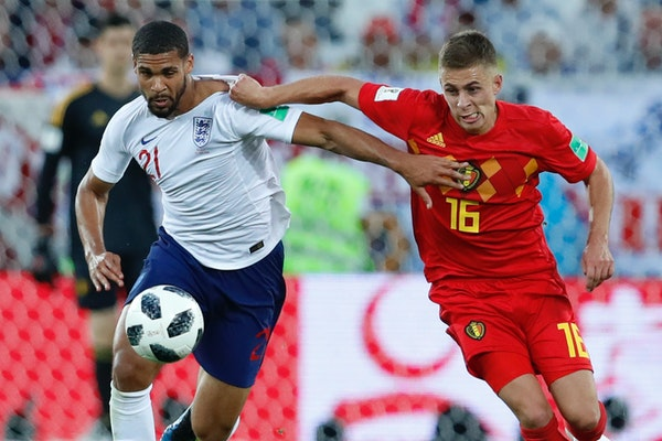 England's Ruben Loftus-Cheek, left, and Belgium's Thorgan Hazard fight for the ball during the Group G match. Both teams advanced.