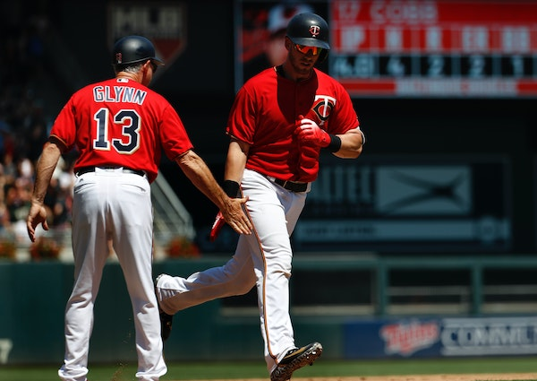 The Twins' Mitch Garver rounded the bases and slapped hands with third base coach Gene Glynn on a two-run home run off Orioles pitcher Alex Cobb in th