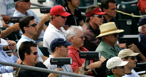 In this 2007 file photo, baseball scouts used radar guns to read the speed of a pitch during a spring training baseball game between the Florida Marli
