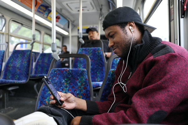 Andre Harris listened to music as he rode the Route 5 bus on his way to his job at the Mall of America.