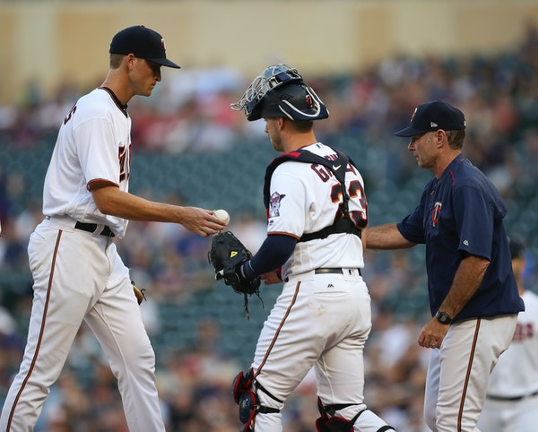 Aaron Slegers handed the ball to manager Paul Molitor after being pulled in the second inning Tuesday at Target Field.