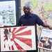 Life lessons: English teacher Bijoun Eric Jordan, who showed off art created by students to be auctioned, has raised money to bring his Brooklyn stude