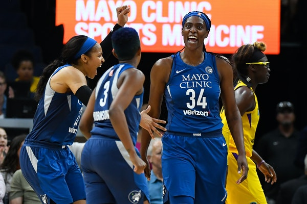 Lynx forward Maya Moore (23), guard Danielle Robinson (3) and center Sylvia Fowles celebrated a basket scored by Fowles in the second quarter against