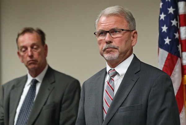 Minnesota Department of Corrections Commissioner Tom Roy spoke Thursday as Washington County Attorney Pete Orput stood next to him.