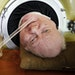Paul Alexander looks out from inside his iron lung at his home in Dallas on Friday, April 27, 2018. Now in his 70s, Alexander is one of the few people