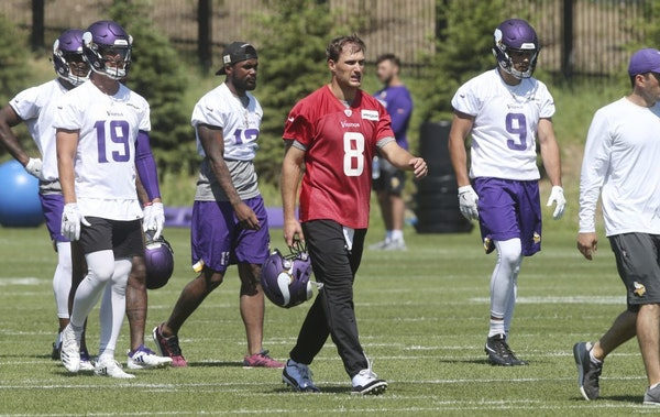 Minnesota Vikings quarterback Kirk Cousins (8) leads offensive players to another part of the field in practice at the NFL football team's training ca