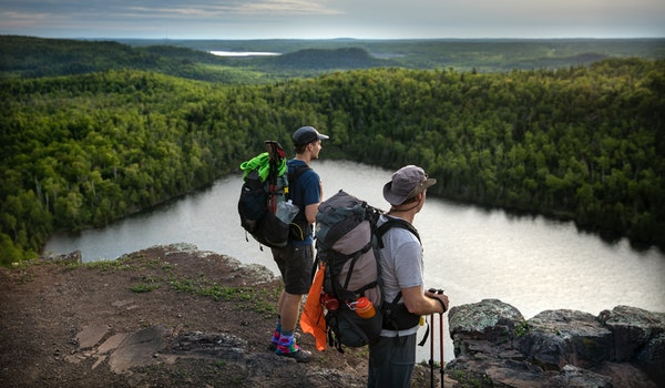 Day-7 - One of the most stunning vistas along the Superior Hiking Trail is the overlook at Bean Lake north of Silver Bay. Here, father and son hikers,