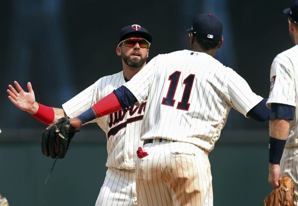 Minnesota Twins outfielder Jake Cave, left, and Jorge Polanco celebrate after the Twins beat the Kansas City Royals 8-5 in a baseball game Wednesday,