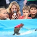 Spectators watched as Twiggy, the water-skiing squirrel, performed Thursday, July 19, 2018 outside US Bank Stadium as part of X Fest. The squirrel, th
