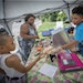 Thirteen-year-old hot dog entrepreneur Jaequan Faulkner served up a hot dog meals to Yvonne Ross and her son Drameris Ross, 7, at his hot dog stand, M
