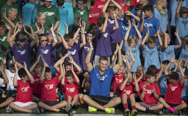Kirk Cousin and campers did the Skol chant during football camp at Hope College Friday June, 29, 2018 in Holland , MN.