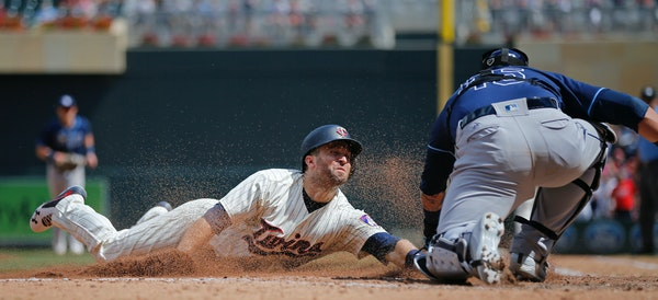 Brian Dozier was out at home plate in the sixth inning