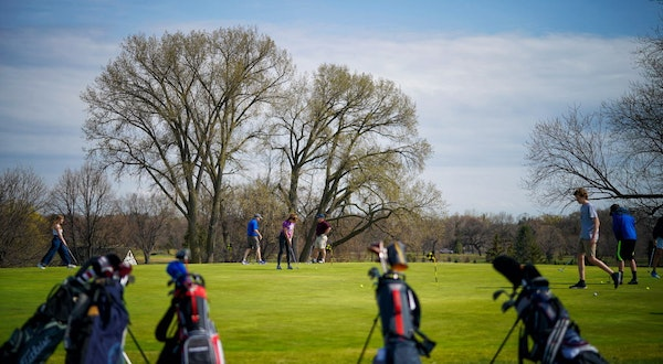 Students practiced putting at Hiawatha Golf Course.