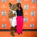 """Lynx center Sylvia Fowles posed with """"Prowl,"""" the team's mascot, on the orange carpet Friday."""