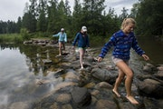 Emma Daniels, Abby MacFarlane and Marie Preston, front to back, crossed the headwaters.