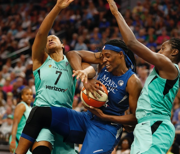 Sylvia Fowles was double-teamed by Kia Vaughn (7) and Tina Charles (31) of the Liberty in the first half.