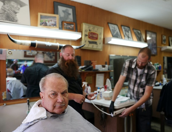 """""""[Trump]'s got a mouth that runs, but he gets things done,"""" Jim Fisher said as he got a haircut at Cowboy Mel's Barber Shop in Anoka."""