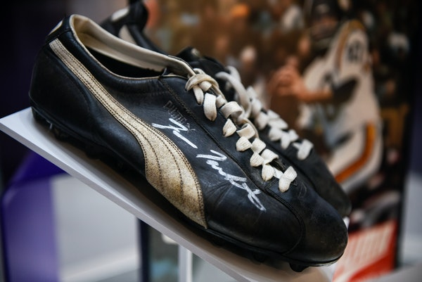 Football shoes signed by Fran Tarkenton at the new Vikings Museum.