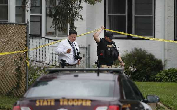 Police officers investigated the scene of a shooting between a suspect and a South St. Paul police officer in South St. Paul, Minn., Thursday, July 19