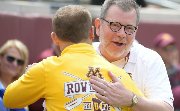 Outgoing University of Minnesota President Eric Kaler greeted Gophers football coach P.J. Fleck during the 2017 spring game.