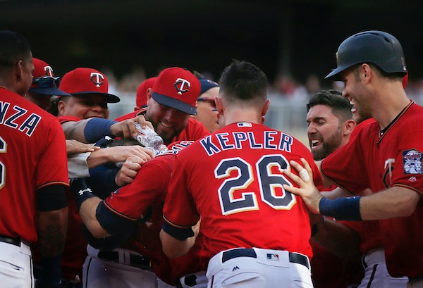 Brian Dozier(2) is greeted by the Twins player for hitting the game winning grand slam to end the game in the 10 innings.
