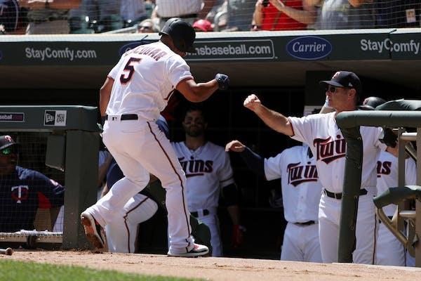 Minnesota Twins third baseman Eduardo Escobar (5) celebrated with Minnesota Twins manager Paul Molitor (4) after hitting a two run home run in the fir