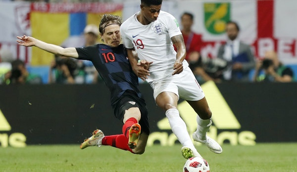 Croatia's Luka Modric, left, taking on England's Marcus Rashford in the semifinal match, is among key players to watch in the World Cup final matc