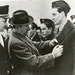 Red Sox star Ted Williams, right, being given a military pin for his service during World War II.