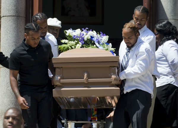 Pallbearers carried the casket holding Blevins down the steps of the church and to the hearse.