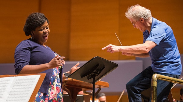 "Soprano Goitsemang Lehobye sings ""Harmonia Ubuntu"" as Osmo V‰nsk‰ conducts during rehearsal. ] LEILA NAVIDI ï leila.navidi@startribune.com BACKGR"
