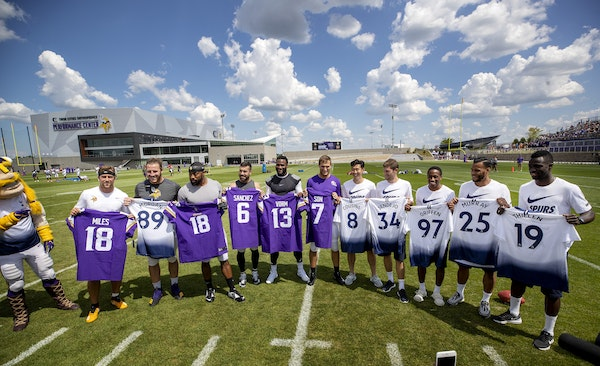 Vikings players posed with players from Tottenham Hotspur at the new TCO Performance Center in Eagan.