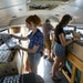 From left, Alison Caldwell, Chris Lankford and Brita Mackey looked at records in the Rockin' Roller bus.