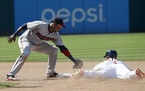 Greg Allen safely steals second base as Jorge Polanco is late with the tag
