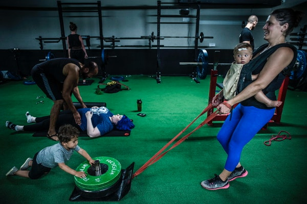 """Maura Caldwell says babywearing is a """"valuable and essential"""" part of her gym workouts."""