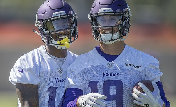 Is having two top, highly-paid receivers in Stefon Diggs, left, and Adam Thielen a necessity for the Vikings or a luxury they can't afford?.